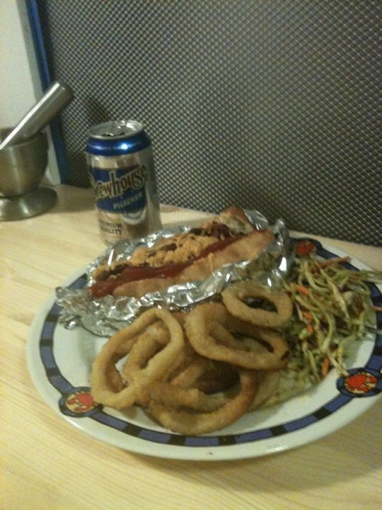 Chili Cheese Dog, Onion Rings, Broccoli Slaw and Pilsner